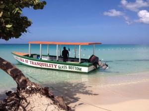 Negril, Glass bottom boat, beach, sun, snorkeling, Explore Jamaica